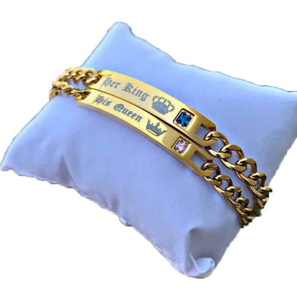 A pair of gold king and queen bracelets