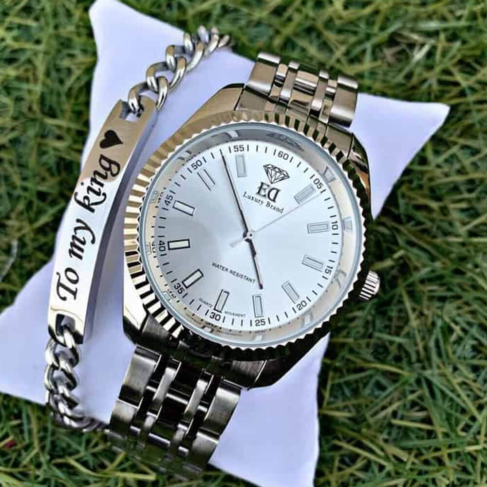 A silver watch and bracelet set to my king