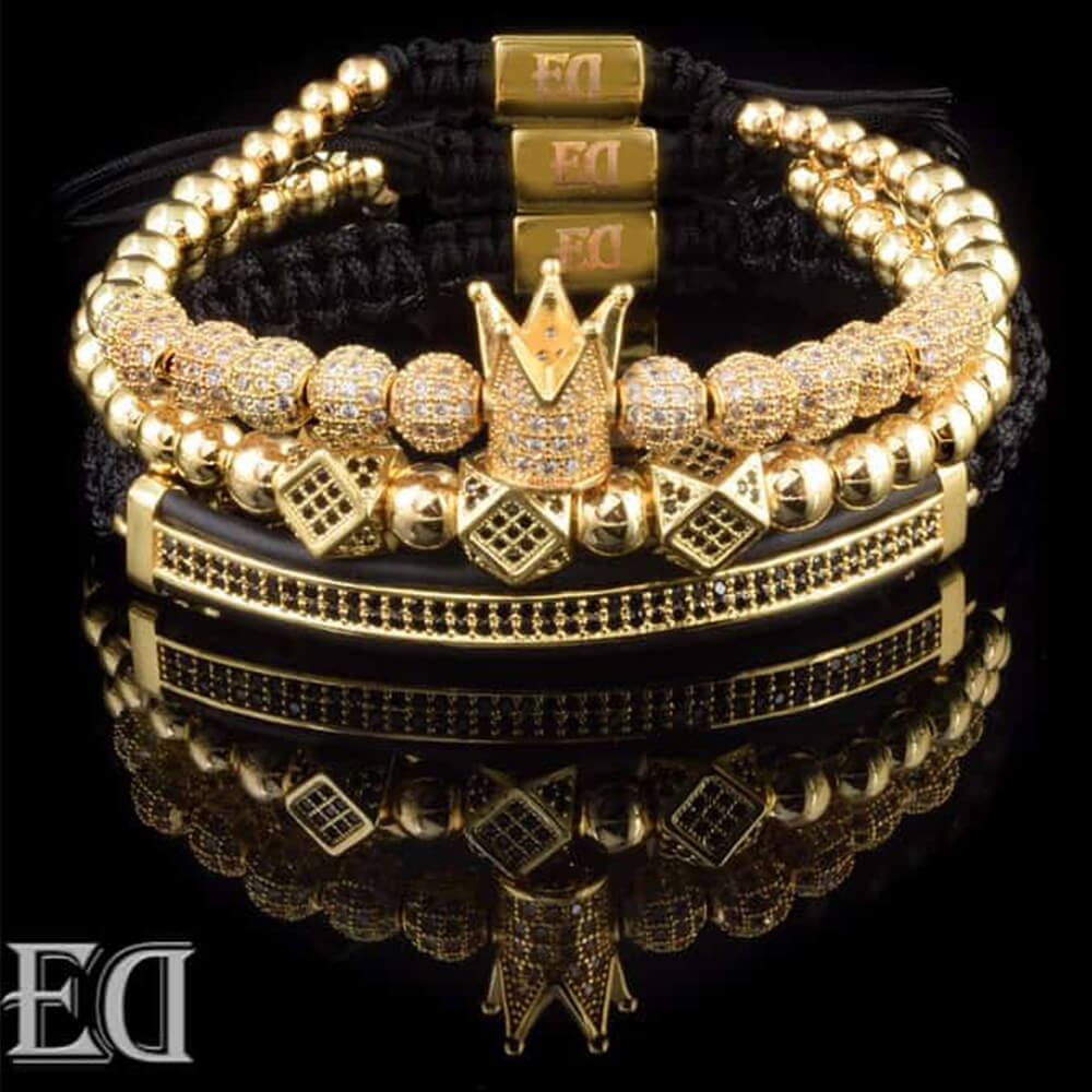Set of gold bracelets with a crown